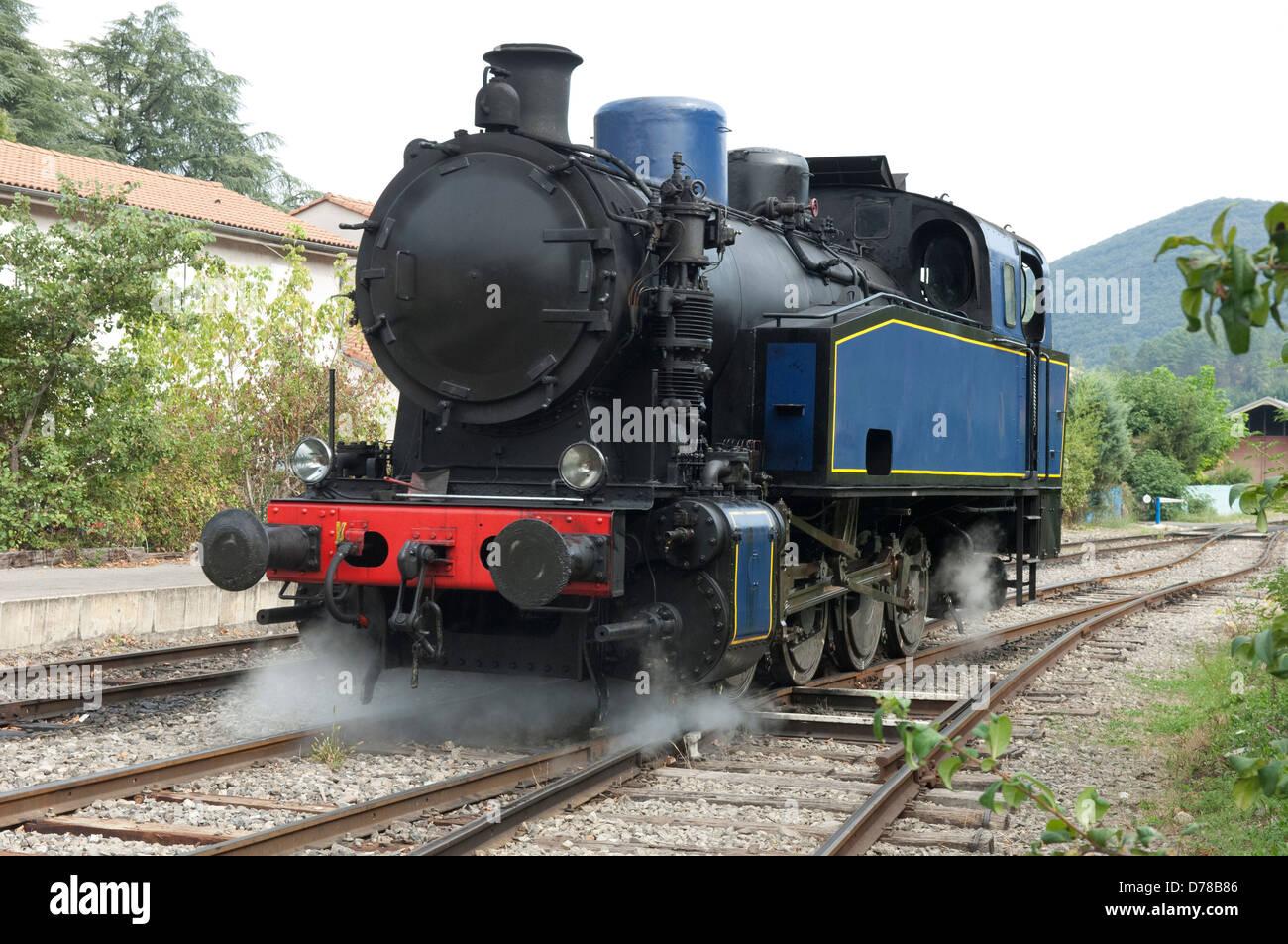 Henschel 040T 2524 steam locomotive approaching station at St Jean du Gard  in the Gard (30) departement of France.