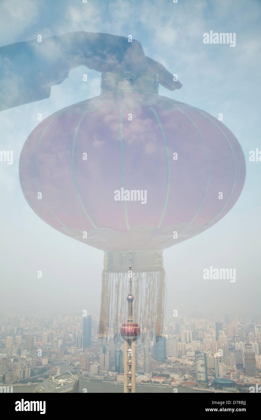 Holding Chinese Lantern, Shanghai Skyline - Stock Image