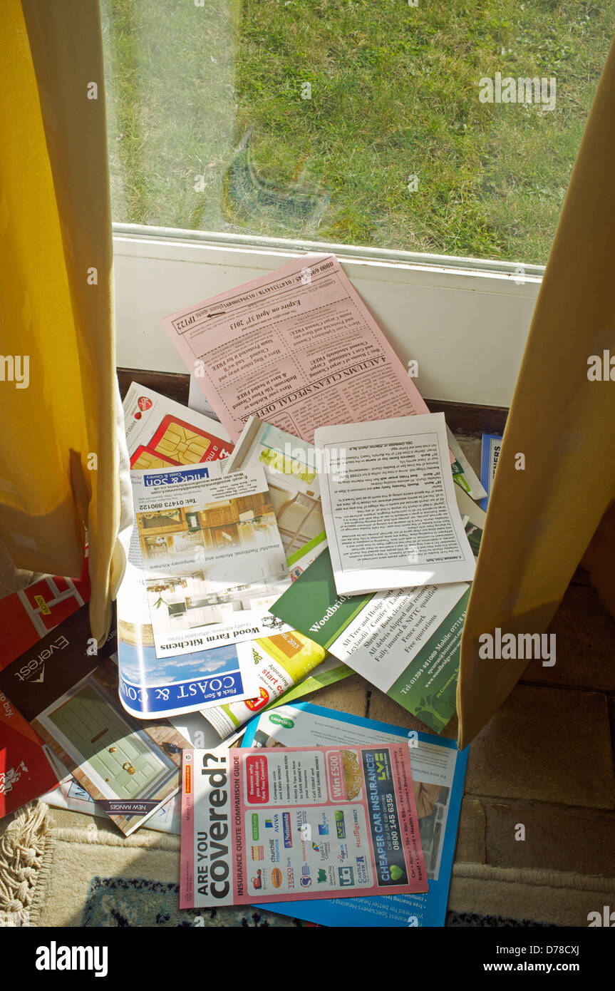 Flyers and sales information know as Junk mail - Stock Image
