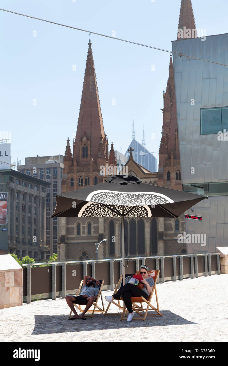 Relaxing at Federation Square, Victoria, Australia - Stock Image