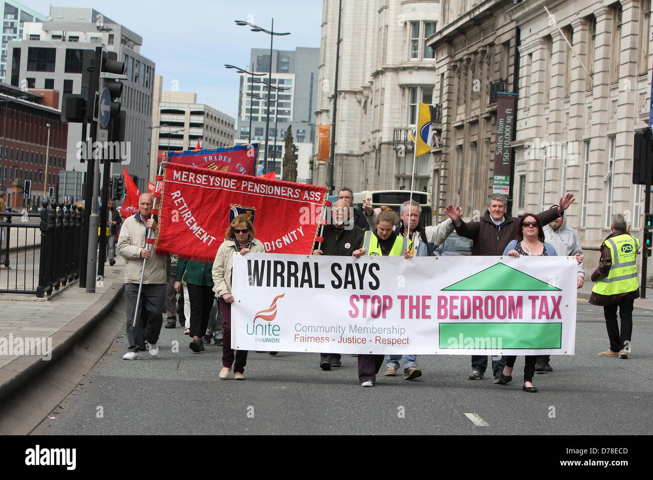 A union organised march through Liverpool city centre against government cuts on May 1, 2013. - Stock Image