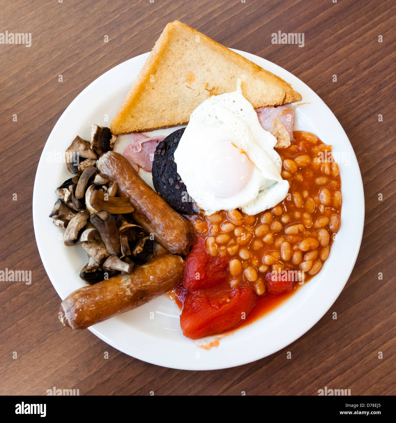 Full English breakfast, with black pudding fry up at a cafe. Fried breakfast overhead food UK. - Stock Image