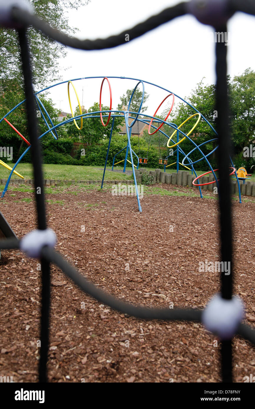 Children's public playground seen through climbing net - Stock Image