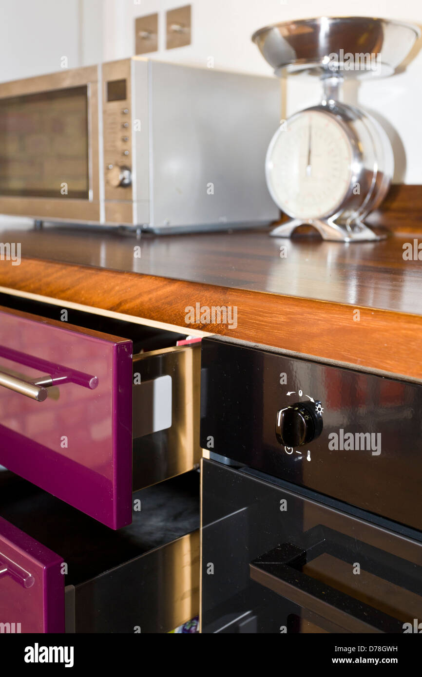 Kitchen drawers and work surface in close up - Stock Image