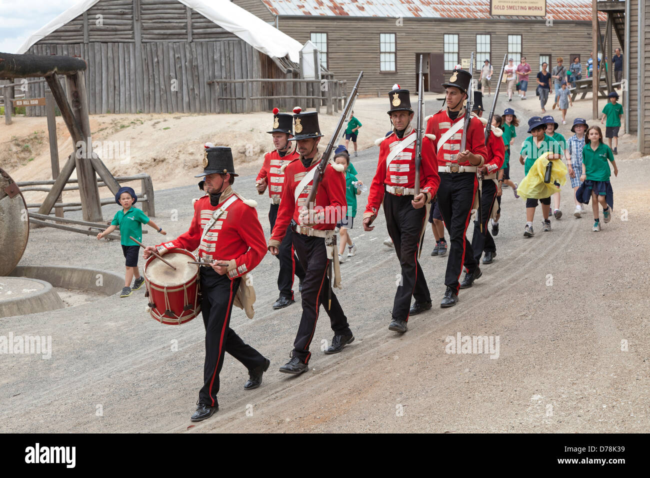 A patrol of British Redcoat soldiers march in formation in Sovereign Hill's former gold mining site in Ballarat, - Stock Image