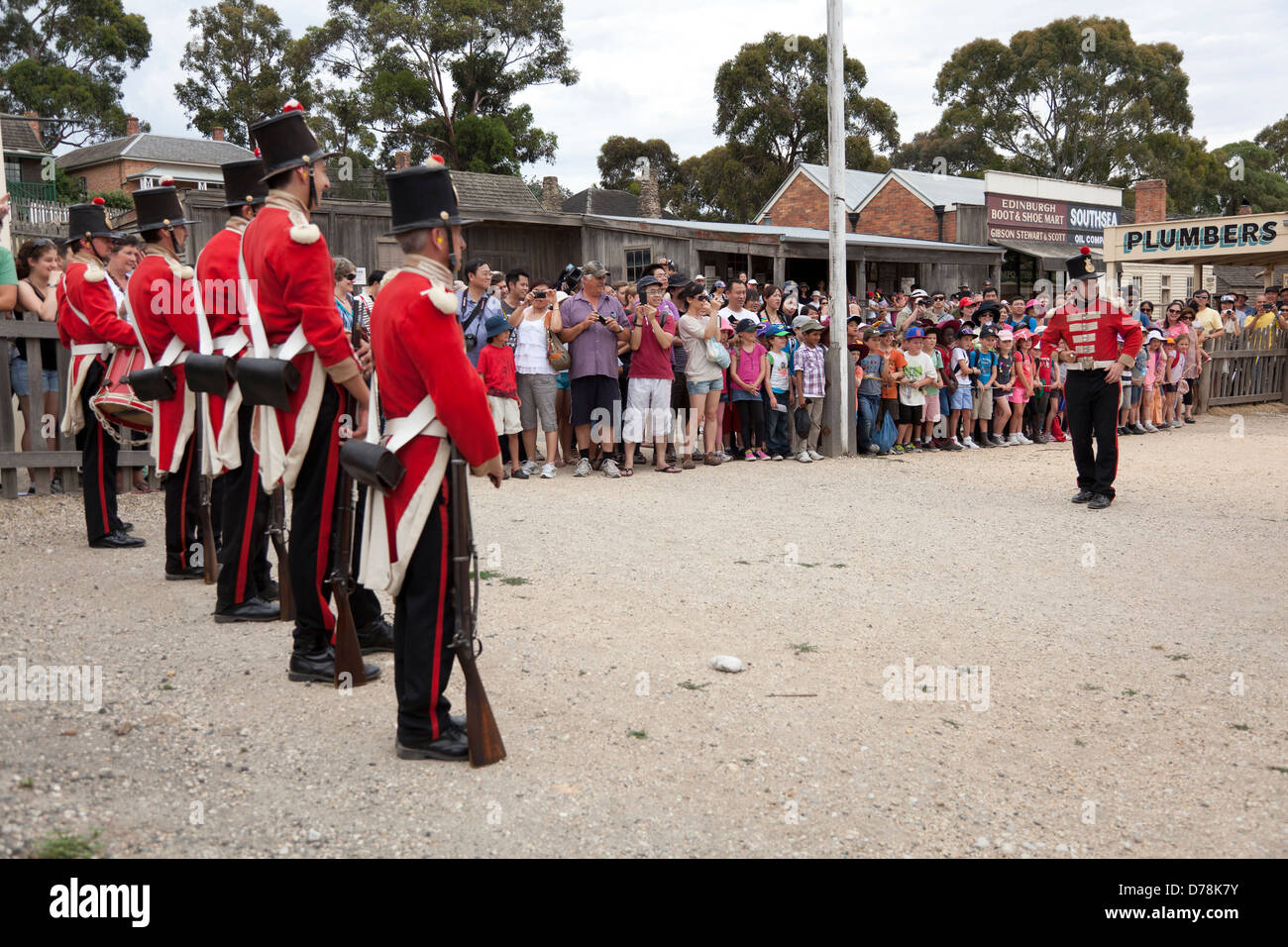 A patrol of British Redcoat soldiers in Sovereign Hill's former gold mining site in Ballarat, Australia - Stock Image