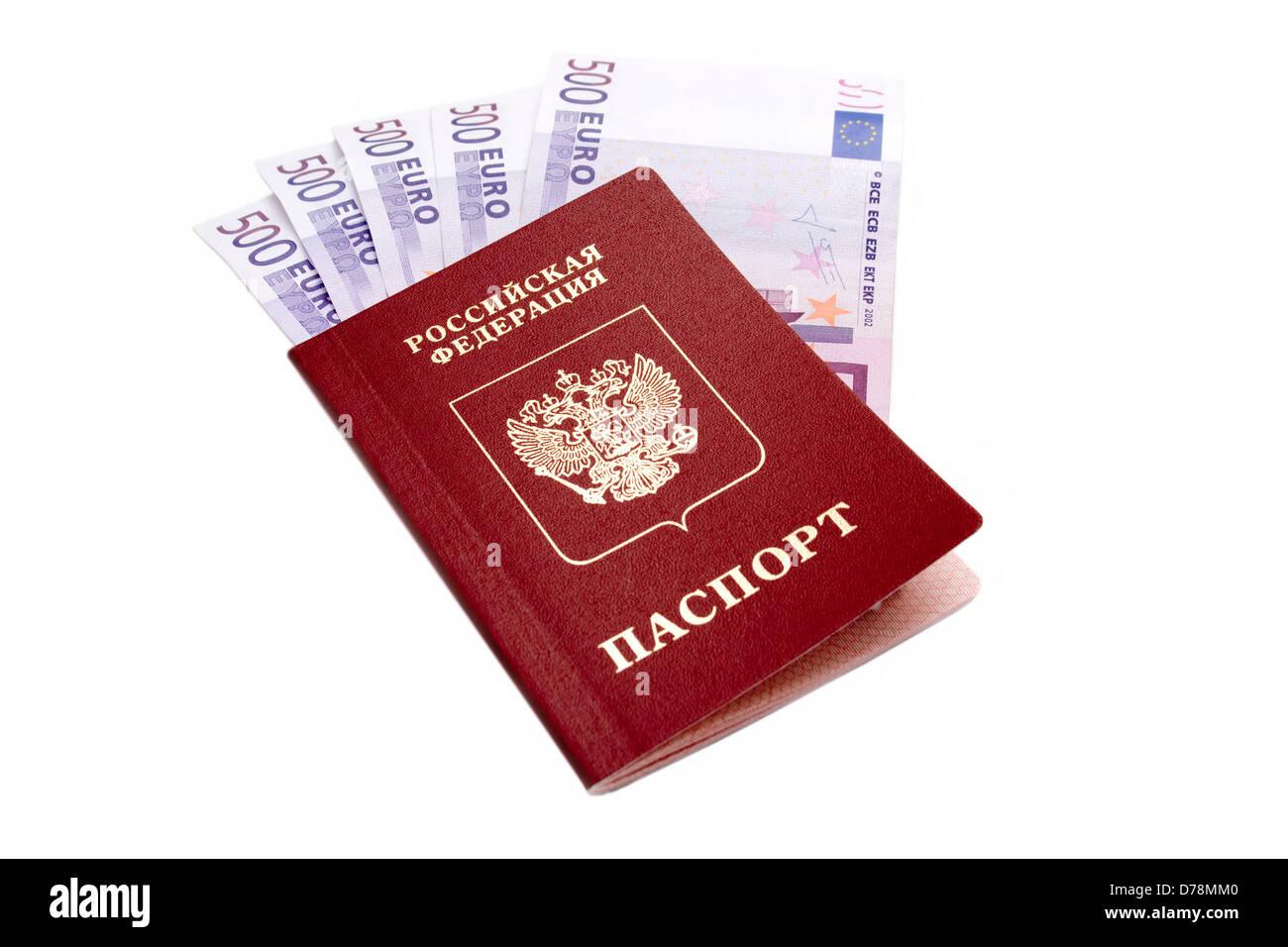 Russian international passport and money on white background - Stock Image