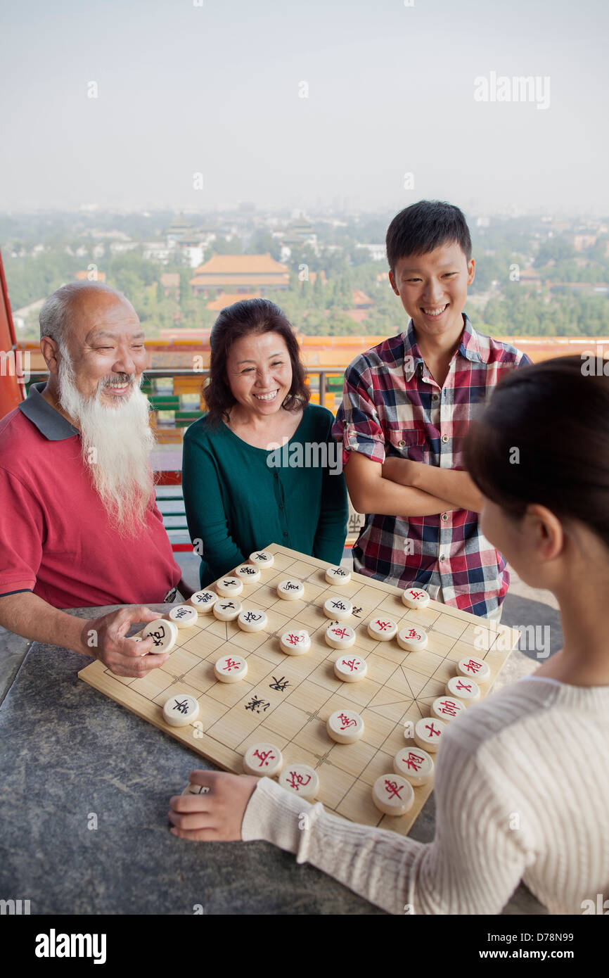 Chinese Family Playing Chinese Chess (Xiang Qi) - Stock Image