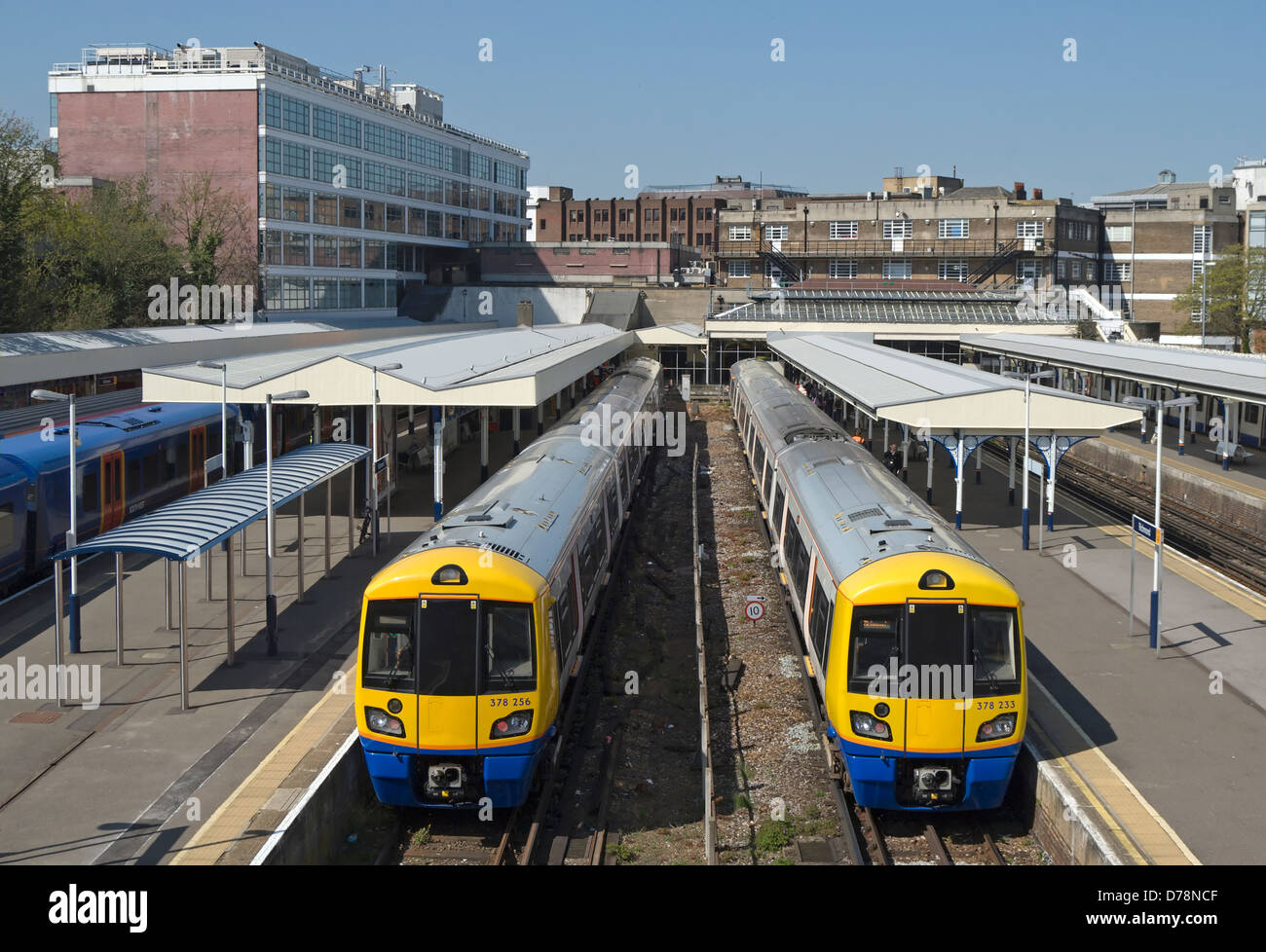 side by side trains at richmond station, richmond upon thames, surrey, england - Stock Image