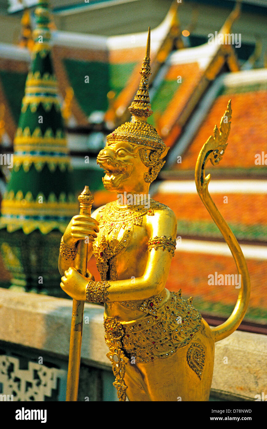 A mythical creature is one of the beautiful gilded figures in the Wat Phra Kaeo, in the grounds of the Grand Palace, - Stock Image