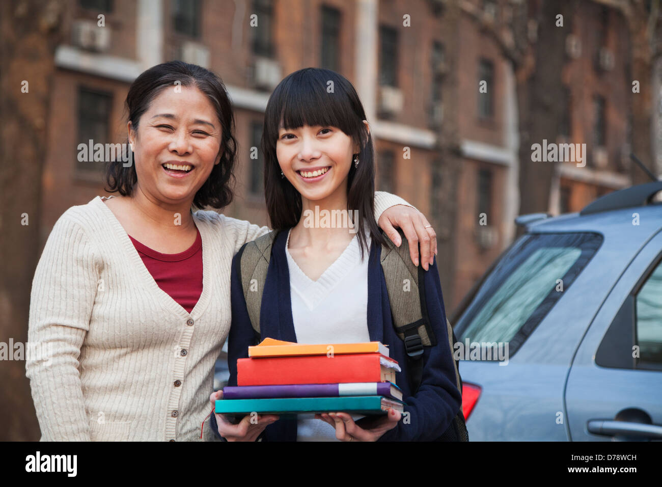 Mother and daughter portrait in front of dormitory - Stock Image