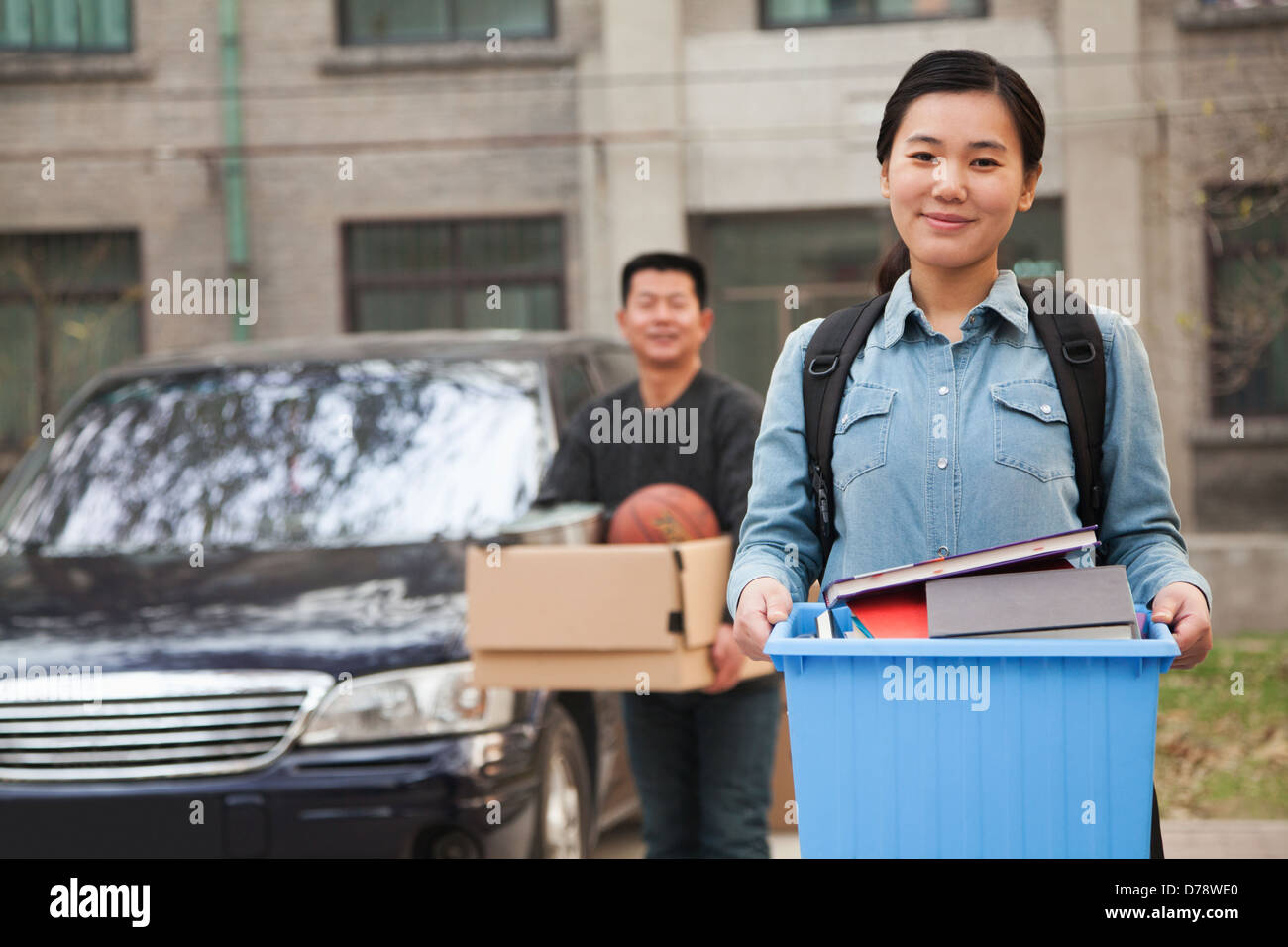 Student portrait in front of dormitory at college - Stock Image