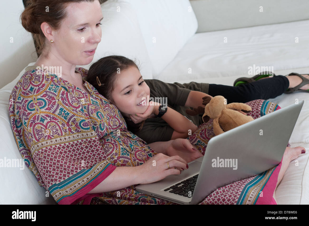 Mother and daughter with laptop - Stock Image