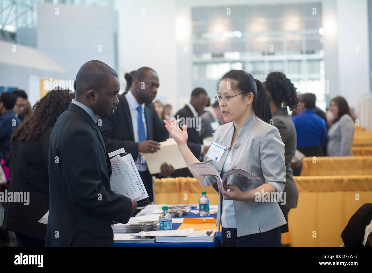 Job seekers attend the CUNY Big Apple Job and Internship Fair at the Jacob Javits Convention Center in New York - Stock Image
