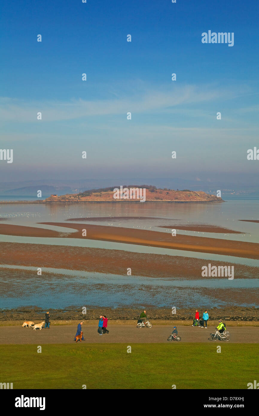 Dog walkers and Cyclists on Cramond Foreshore, Edinburgh - Stock Image