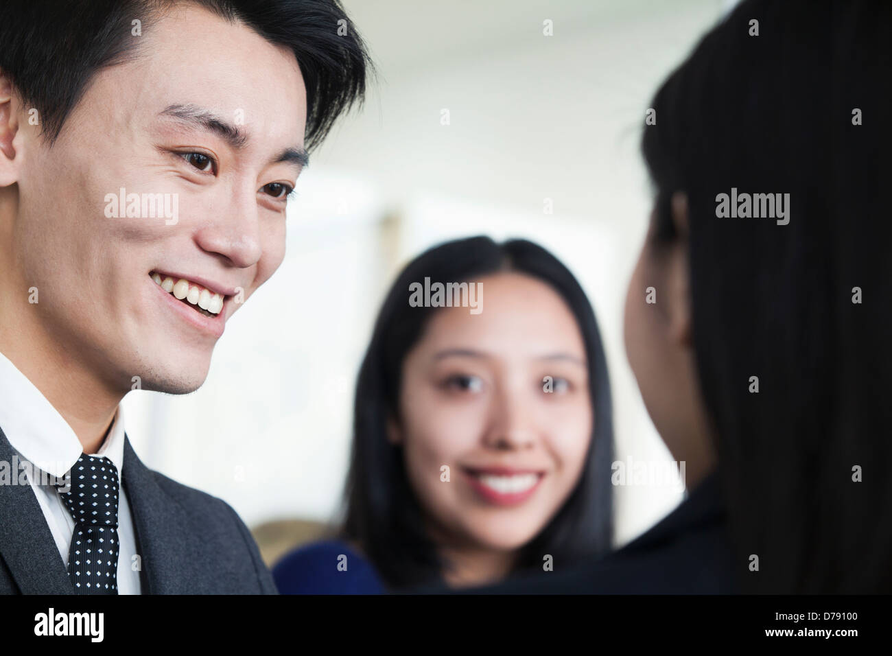 Co-workers talking in office Stock Photo