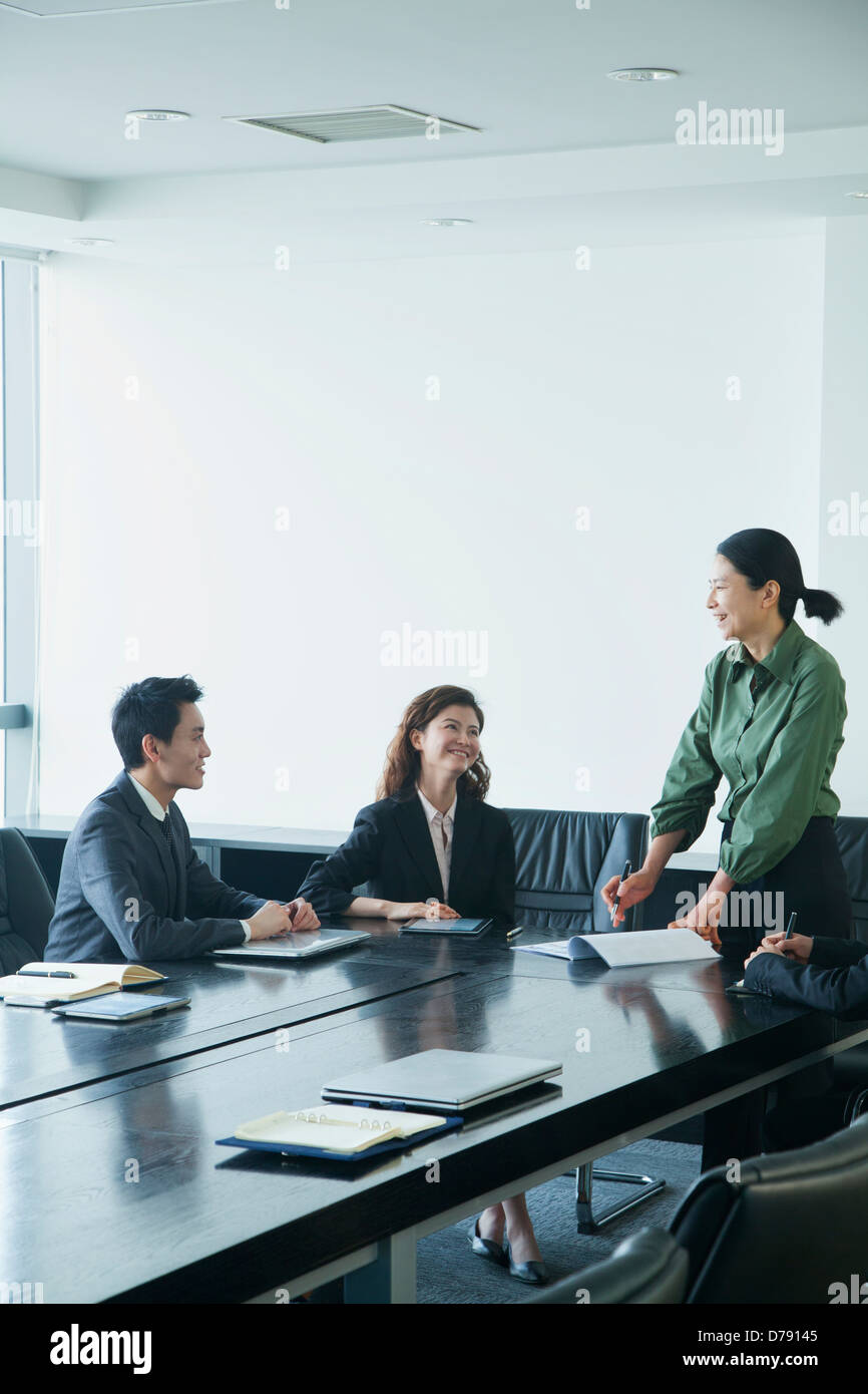 Co-workers in meeting room - Stock Image