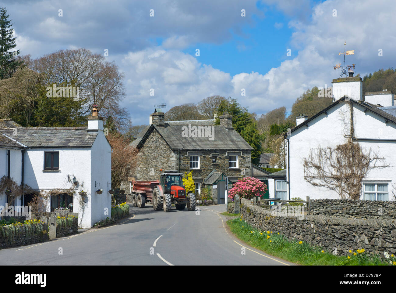 Tractor and trailer in the village of Near Sawrey, Lake District National Park, Cumbria, England UK - Stock Image