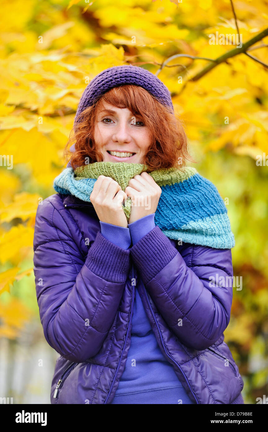 Merry woman in autumnal surroundings , Lebensfrohe Frau in herbstlicher Umgebung - Stock Image