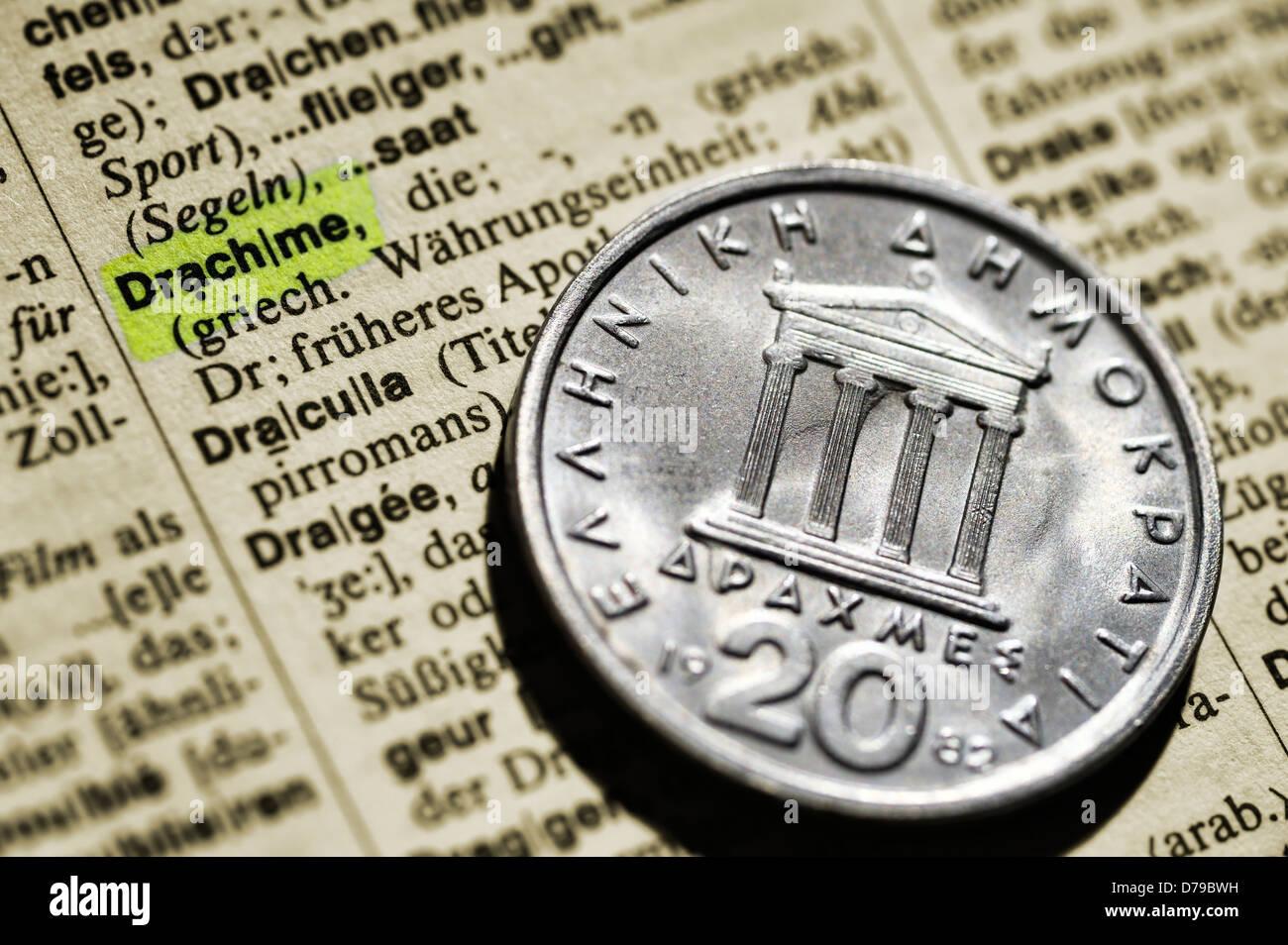 Greek drachm on dictionary , Griechische Drachme auf Wörterbuch - Stock Image