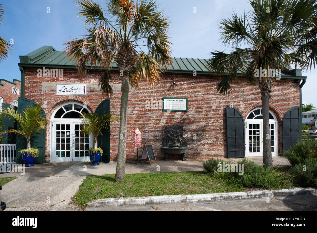 Shops located in historic Sponge Exchange building on Avenue E in downtown Apalachicola, FL, USA - Stock Image