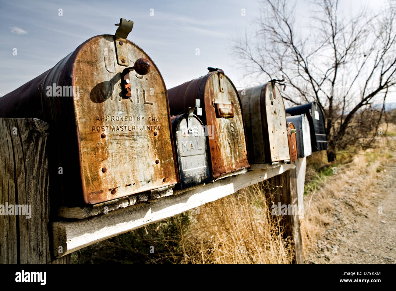 Old vintage mailboxes in rural Midwest United States, late sun - Stock Image