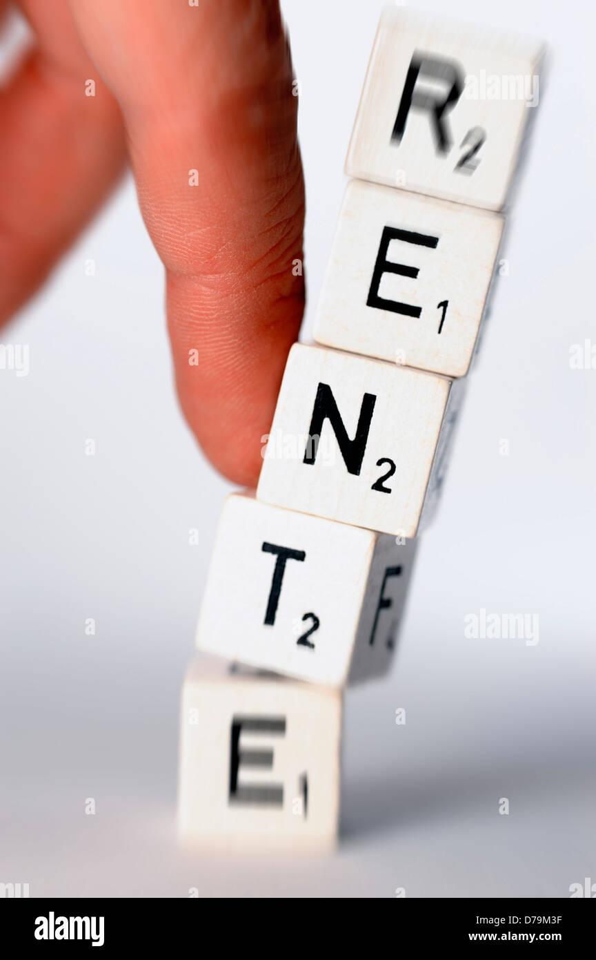 Falling down letter tower with pension stroke, unsafe pensions , Umstürzender Buchstabenturm mit Rente-Schriftzug, - Stock Image