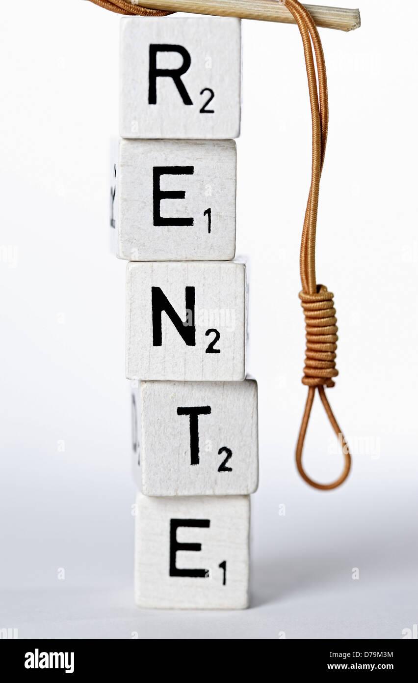 Letter tower with pension stroke and gallows bird, unsafe pensions , Buchstabenturm mit Rente-Schriftzug und Galgenstrick, - Stock Image