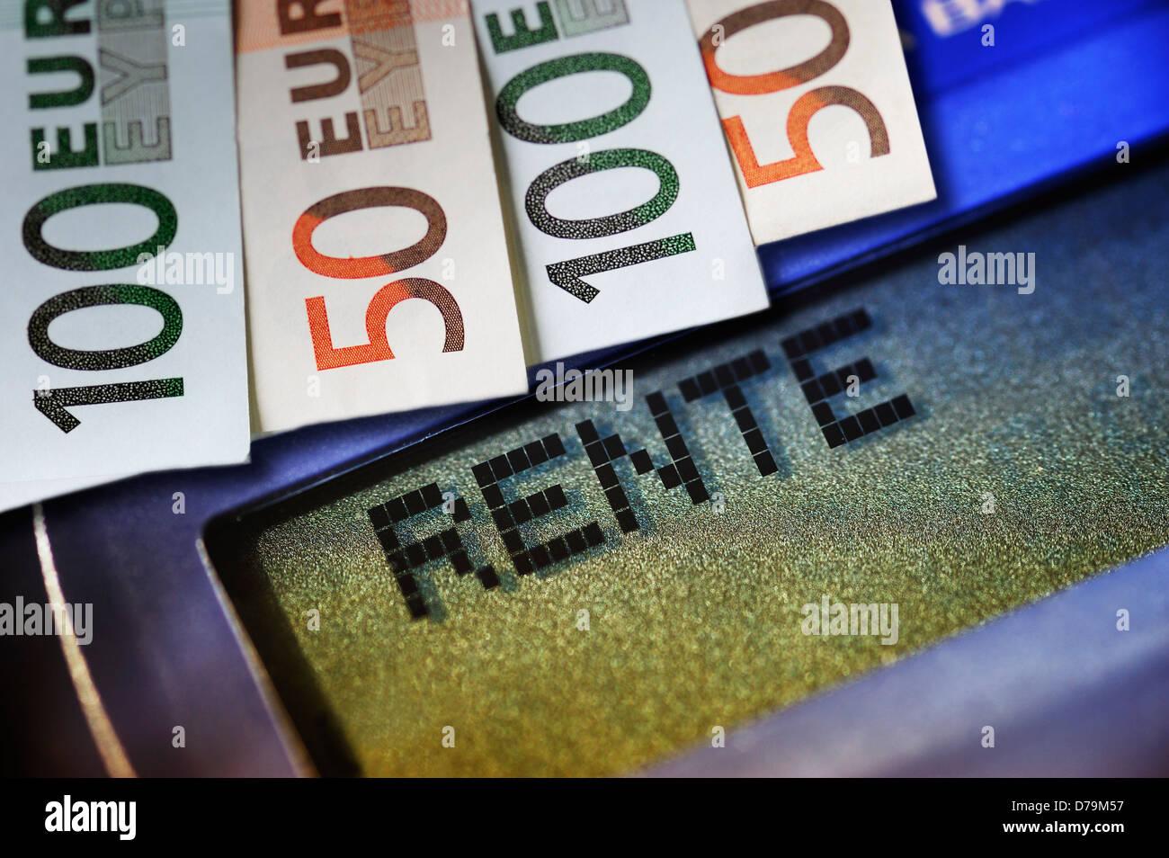Pension stroke on a pocket calculator and bank notes , Rente-Schriftzug auf einem Taschenrechner und Geldscheine Stock Photo