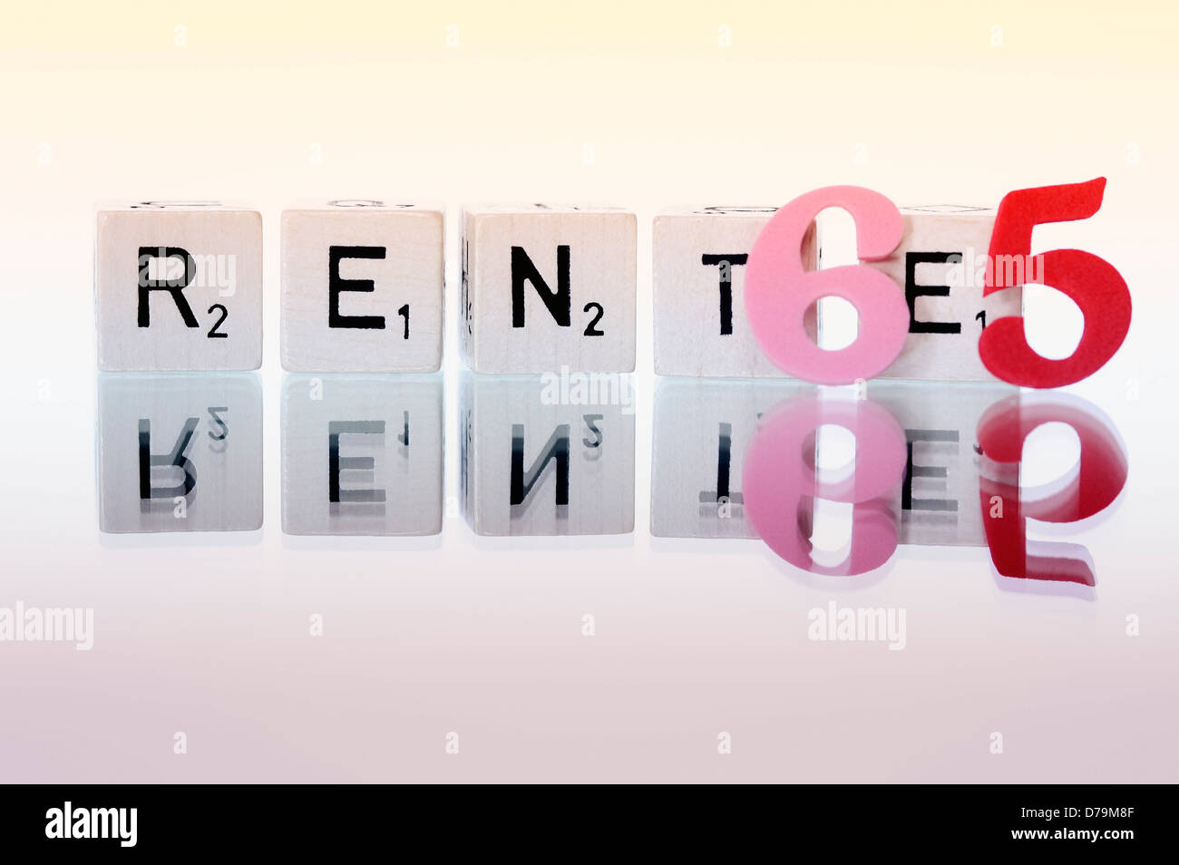 Cube letters with the word Pension, Pension beginning at the age of 65 years , Würfelbuchstaben mit dem Wort Rente, Stock Photo