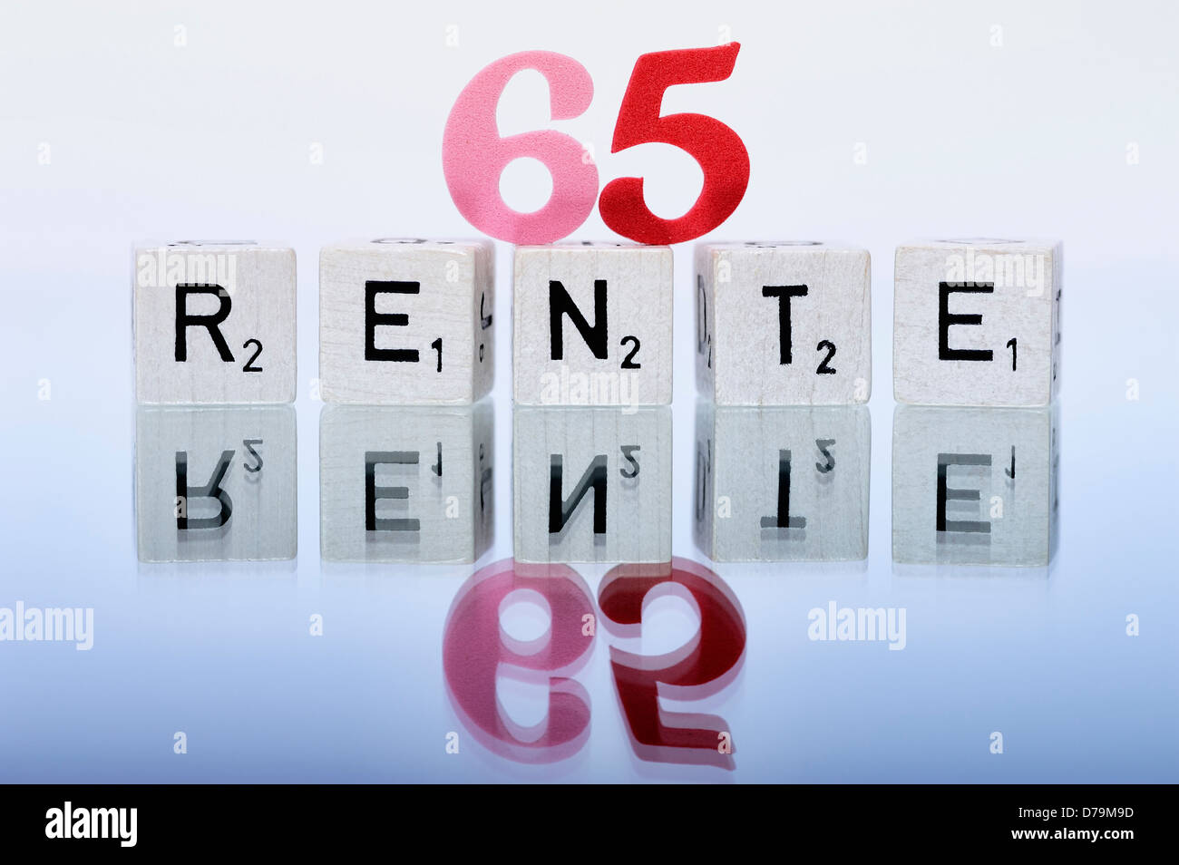 Cube letters with the word Pension, Pension beginning at the age of 65 years , Würfelbuchstaben mit dem Wort - Stock Image