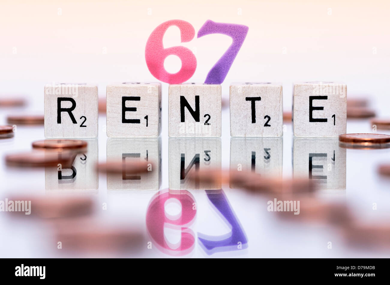 Cube letters with the word Pension, Pension beginning at the age of 67 years , Würfelbuchstaben mit dem Wort - Stock Image
