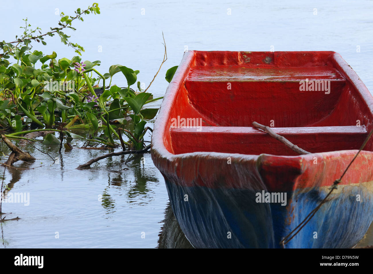 Anchored boat in the Chiriqui river in western Panama (Central America). - Stock Image