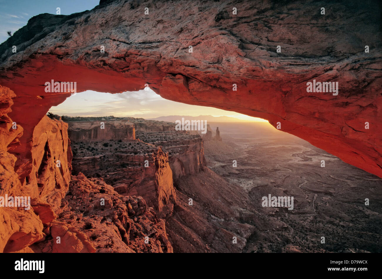 The red glow of Mesa Arch in early sunrise - Stock Image