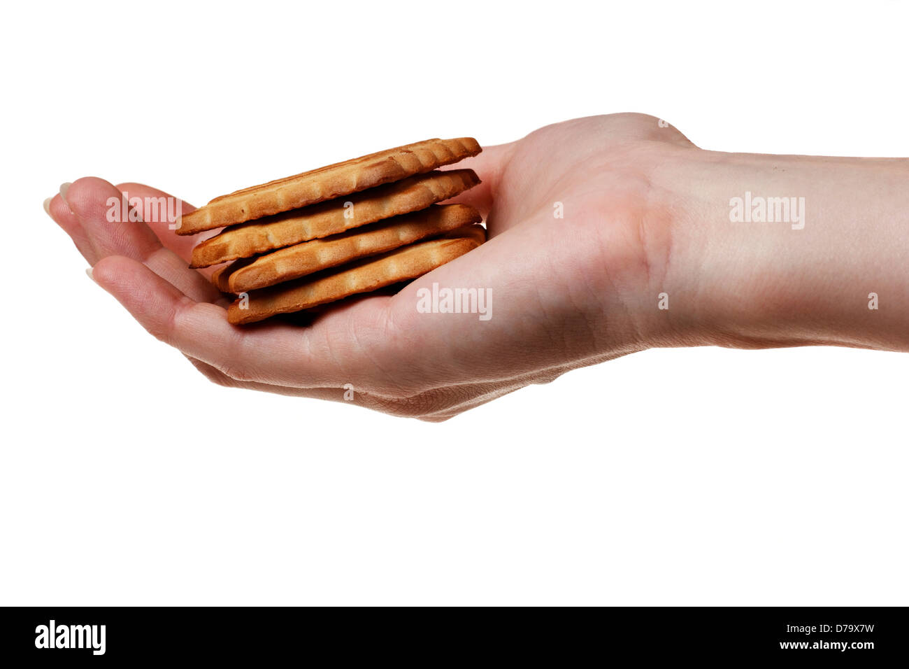 Oatmeal cookies in the woman hand. - Stock Image