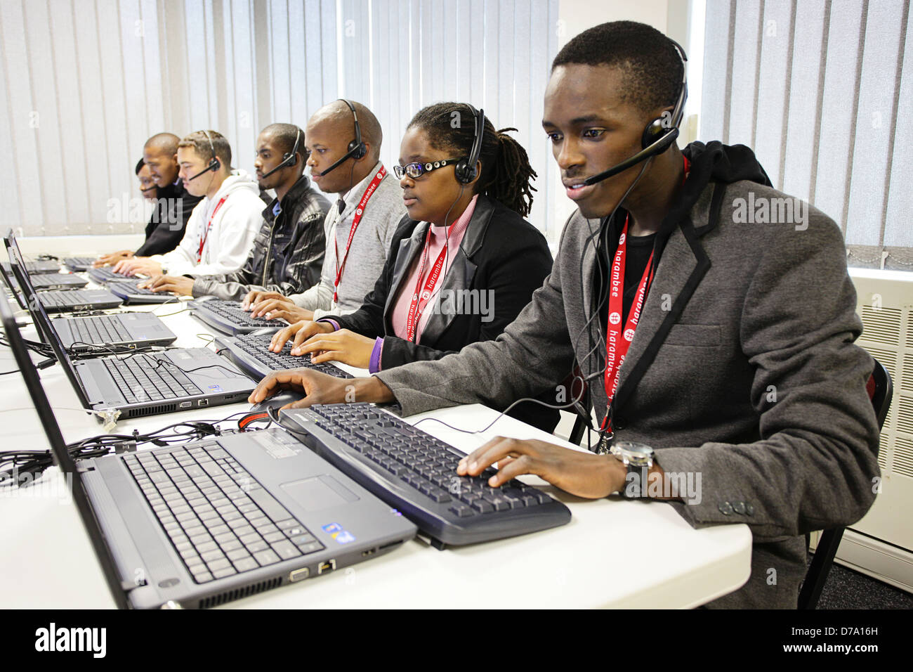 Cape Town based students training to be entry-level workers typing on laptops. - Stock Image
