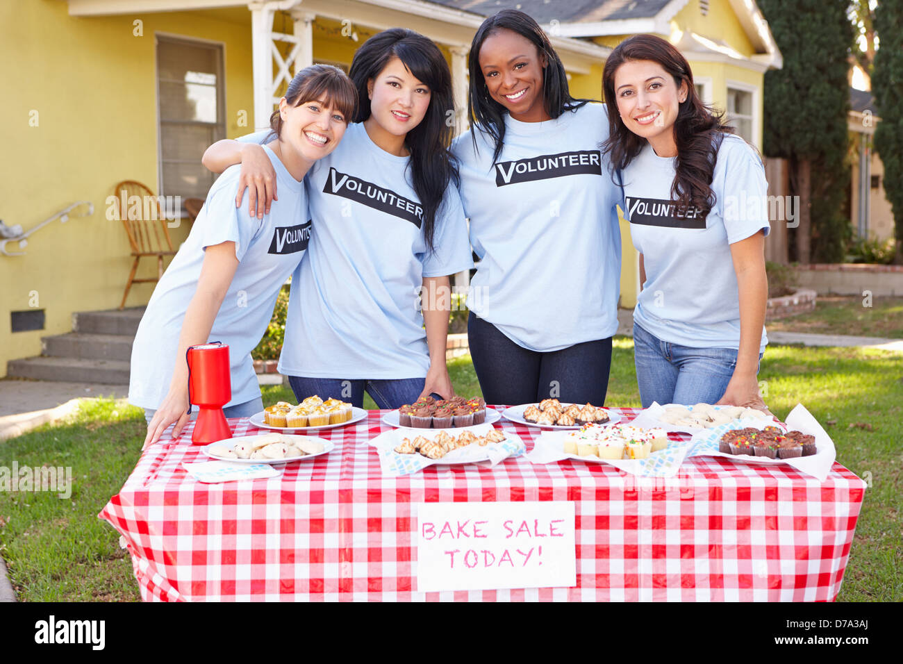 Team Of Women Running Charity Bake Sale - Stock Image