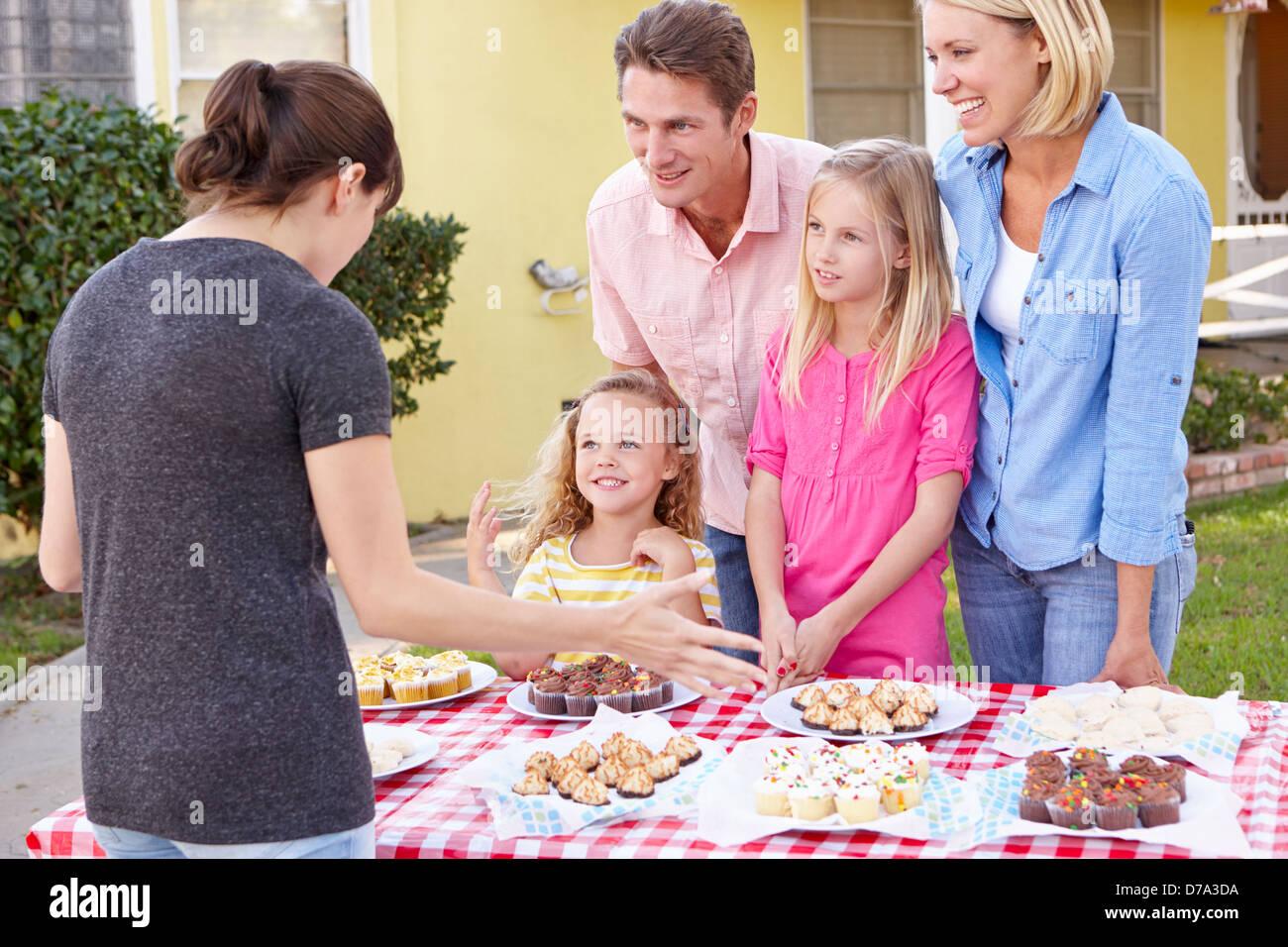 Family Running Charity Bake Sale Stock Photo