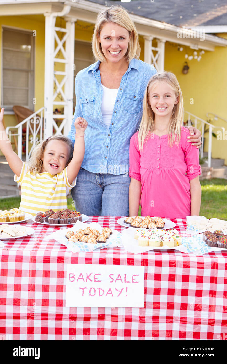 Mother And Children Running Charity Bake Sale Stock Photo