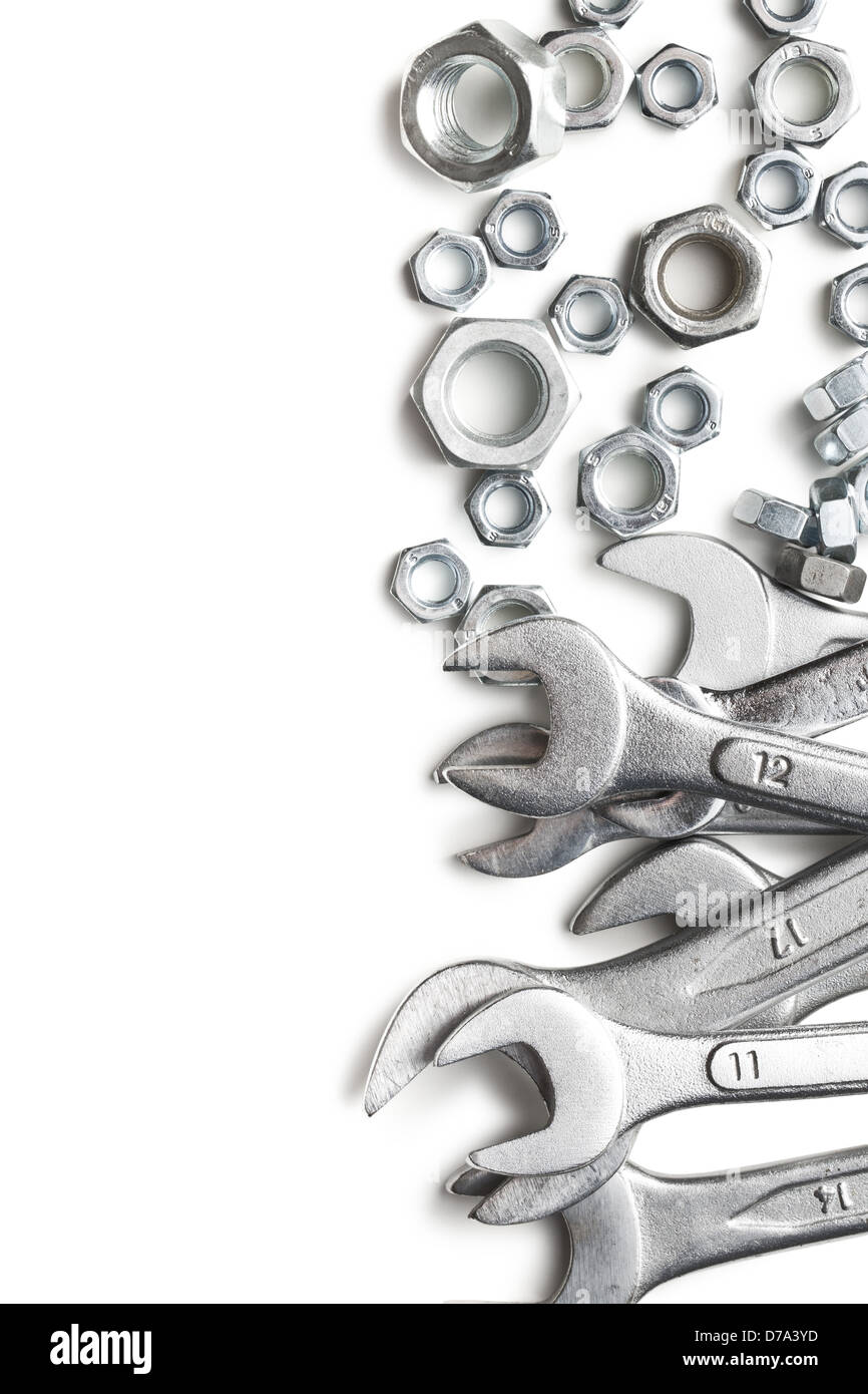 spanners and nuts on white background - Stock Image