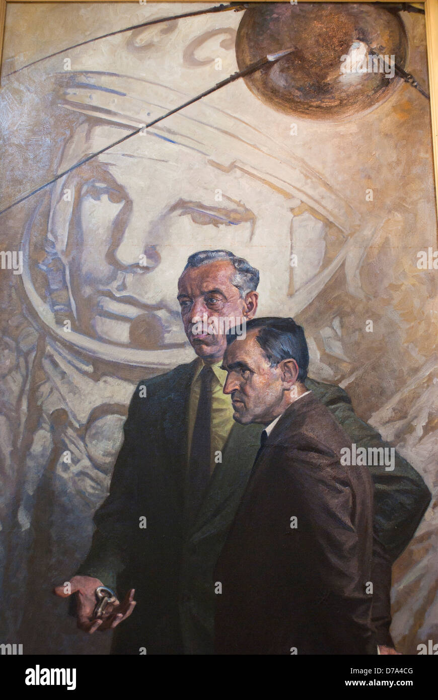 Painting on display in museum showing Sputnik Gagarin Soviet engineers one holding launch key symbolizing Key To - Stock Image