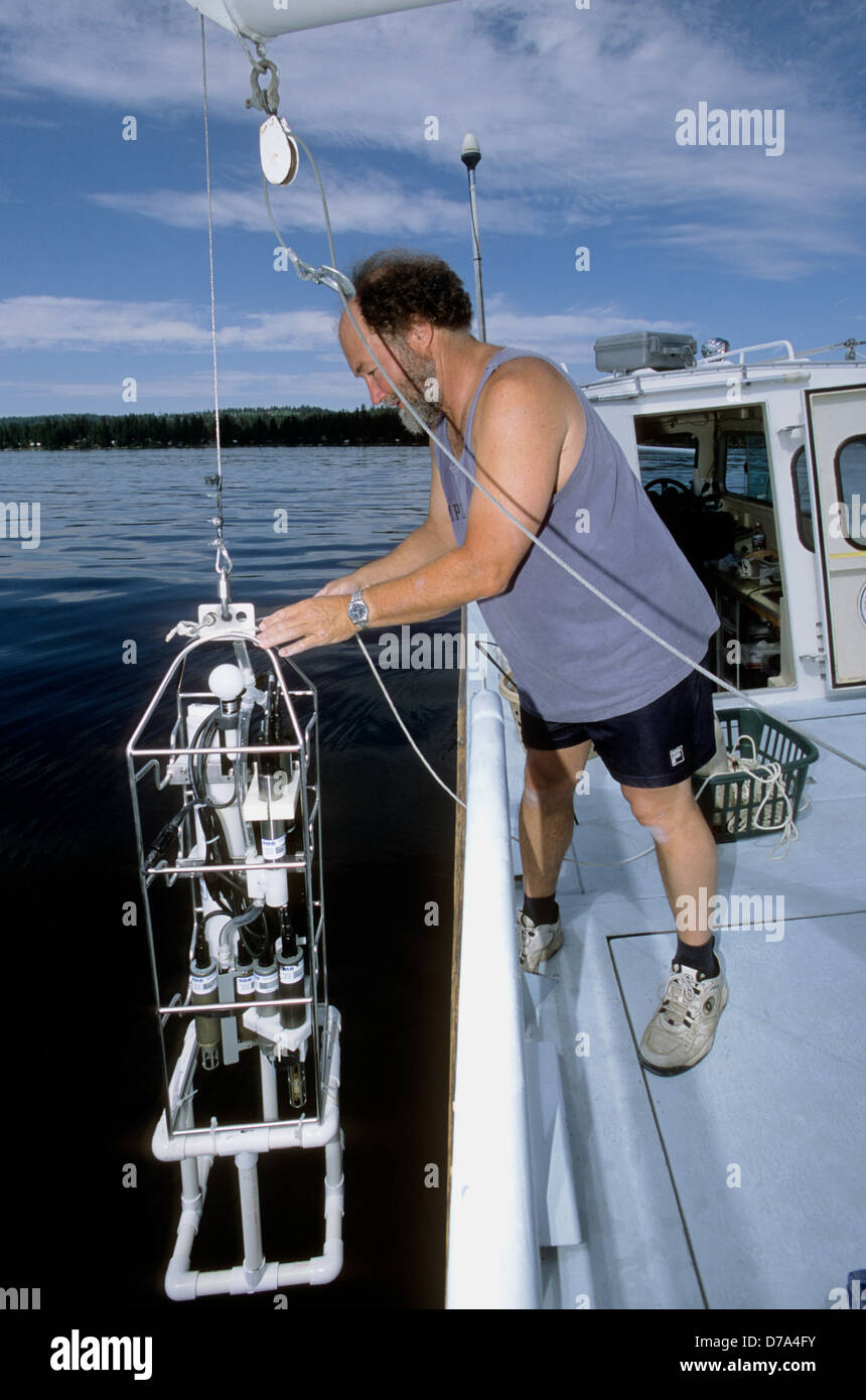 USGS limnologist deploying a multi-parameter water column profiler in Payette Lake in west-central Idaho. - Stock Image