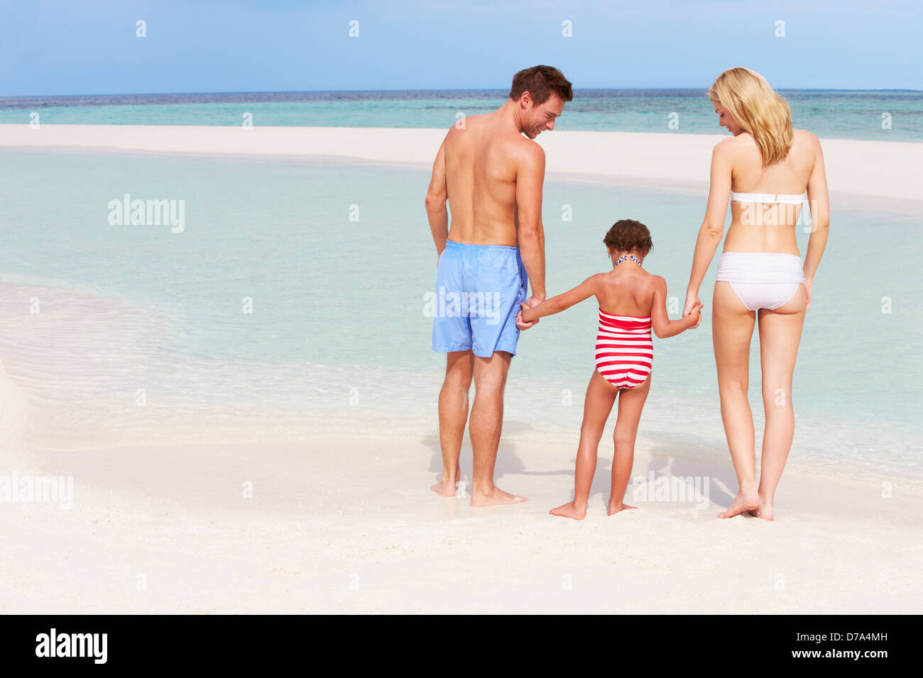 Family Having Fun In Sea On Beach Holiday - Stock Image