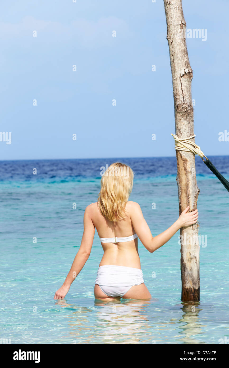 Woman In Bikini Standing In Beautiful Tropical Sea - Stock Image