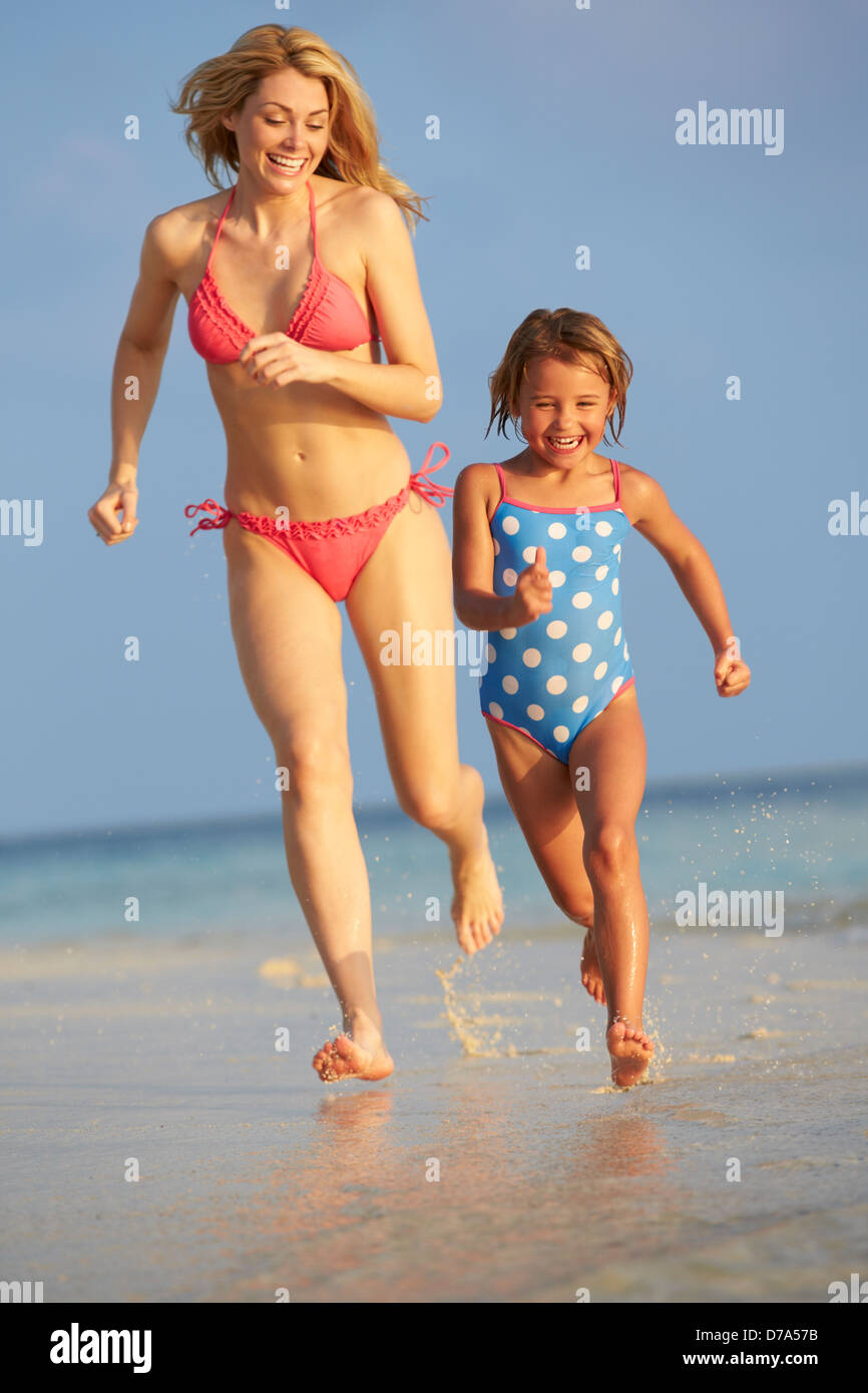 Mother And Daughter Having Fun In Sea On Beach Holiday Stock Photo
