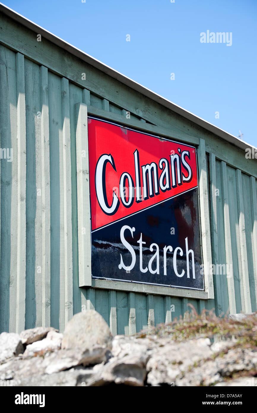 Vintage enamel advertising sign for Colmans Starch England UK United Kingdom GB Great Britain - Stock Image