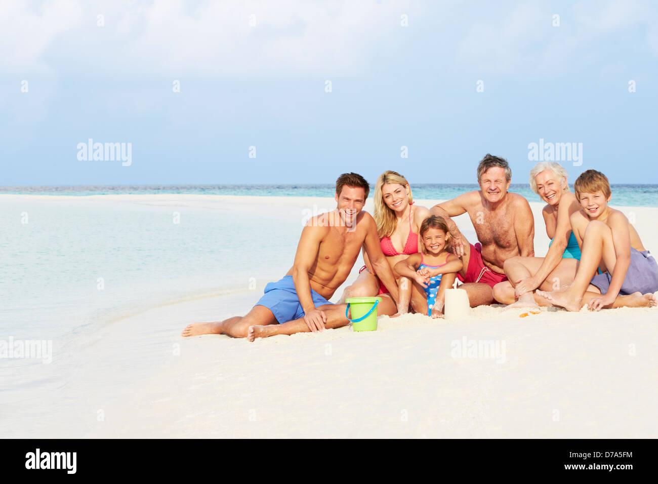 Multi Generation Family Having Fun On Beach Holiday - Stock Image