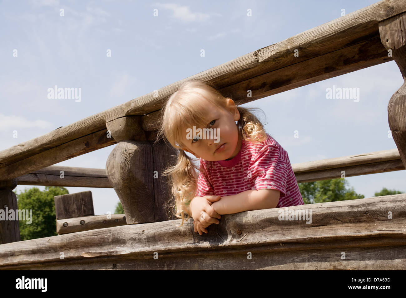 Angry little girl on the playground - Stock Image