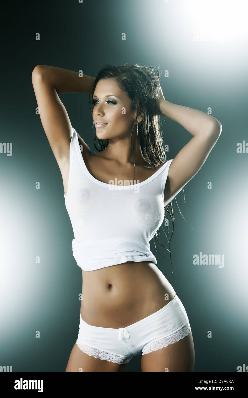 11530c70633 Sexy attractive wet woman wearing white tank top and panties Stock ...
