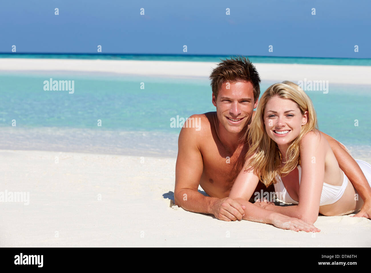 Couple Enjoying Beach Holiday - Stock Image